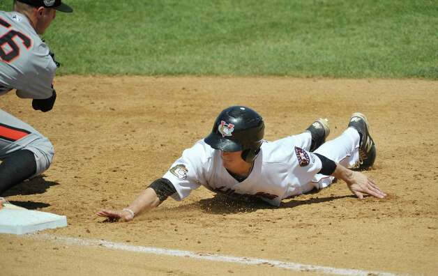 ValleyCats Johnny Sewald slides safely back into first base  during their game against Aberdeen on Monday, July 20, 2015, in Troy, N.Y.   (Paul Buckowski / Times Union) Photo: PAUL BUCKOWSKI / 00032632A