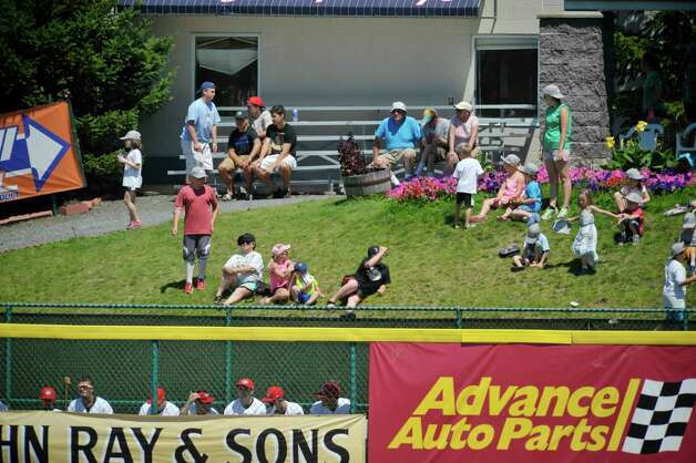 Children and adults watch the ValleyCats game from a hill behind the bullpen on Monday, July 20, 2015, in Troy, N.Y.   (Paul Buckowski / Times Union) Photo: PAUL BUCKOWSKI / 00032632A