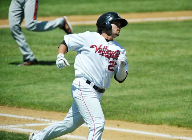 ValleyCats Bryan Muniz rounds first base after getting a hit  during their game against Aberdeen on Monday, July 20, 2015, in Troy, N.Y.   (Paul Buckowski / Times Union) Photo: PAUL BUCKOWSKI / 00032632A