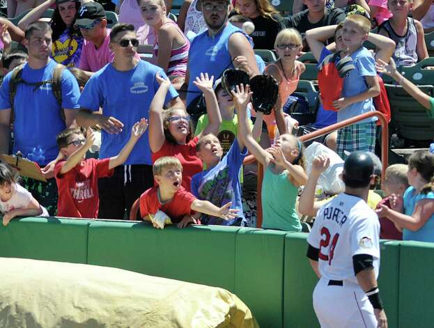 Children from local camps reach up for a baseball thrown to them during a ValleyCats game on Monday, July 20, 2015, in Troy, N.Y.   (Paul Buckowski / Times Union) Photo: PAUL BUCKOWSKI / 00032632A