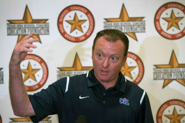 UIL Deputy Director Dr. Jamey Harrison announces that the UIL state championship football games will be played at NRG Stadium this December during a news conference at the Texas High School Coaches Association Coaching School on Monday, July 20, 2015, in Houston.