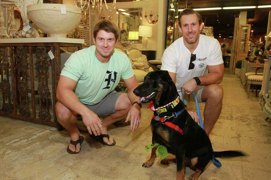 Pro football players Garrett Graham, left, and Owen Daniels with Lola Photo: Gary Fountain, Freelance / Copyright 2015 by Gary Fountain
