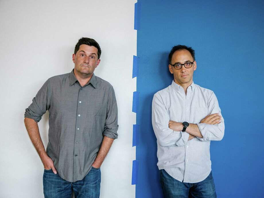 """-- PHOTO MOVED IN ADVANCE AND NOT FOR USE - ONLINE OR IN PRINT - BEFORE JULY 19, 2015. -- Michael Showalter, left, and David Wain, the creators of the 2001 cult comedy """"Wet Hot American Summer,"""" in Los Angeles, July 1, 2015. The satire of 1980s summer camp movies has spawned a prequel series on Netflix, in which now-fortysomethings like Amy Poehler, Paul Rudd and Bradley Cooper play even younger versions of their roles as counselors. (Nathaniel Wood/The New York Times) Photo: NATHANIEL WOOD, STR / NYTNS"""