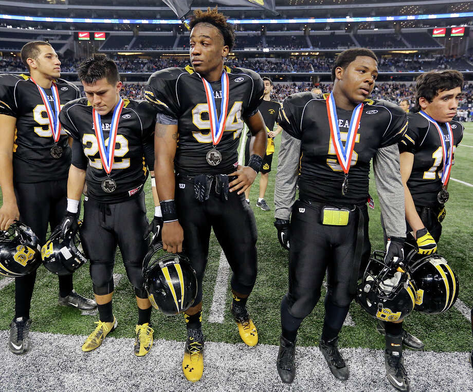 Members of the Brennan Bears react after their Class 4A Division I state championship game with Denton Guyer  Friday Dec. 20, 2013 at AT&T Stadium in Arlington, Tx.  Denton Guyer won 31-14. Photo: Edward A. Ornelas, Staff / San Antonio Express-News / © 2013 San Antonio Express-News