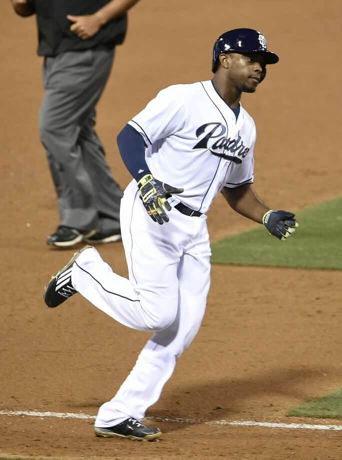 SAN DIEGO, CA - JULY 17:  Justin Upton #10 of the San Diego Padres rounds the base after hitting a solo home run during the eighth inning of a baseball game against the Colorado Rockies at Petco Park July 17, 2015 in San Diego, California.  (Photo by Denis Poroy/Getty Images) Photo: Denis Poroy, Getty Images