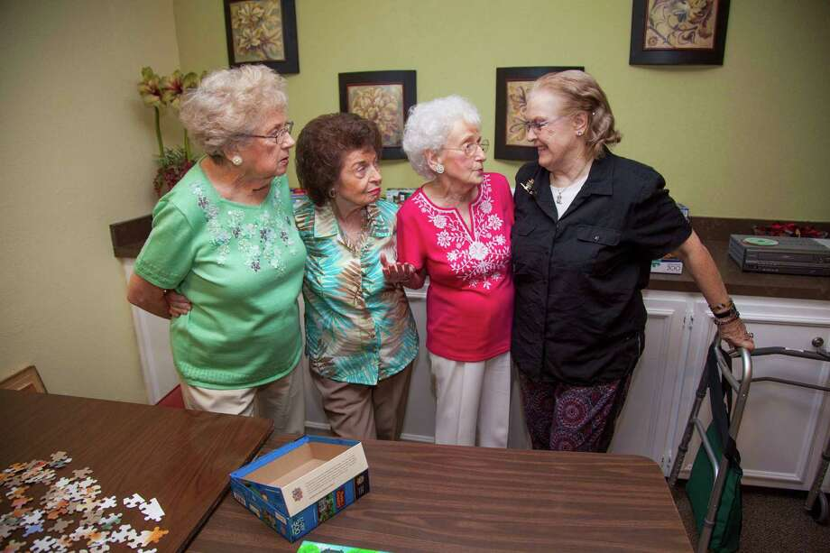 Treemont's Golden Girls, from left, Elizabeth Jahn, Camille Scalise and Betty Davenport trade stories with new resident Marie Lynn Hayes. The Golden Girls host monthly parties to welcome new neighbors.