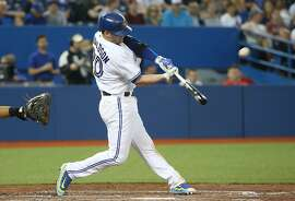TORONTO, CANADA - JULY 17: Josh Donaldson #20 of the Toronto Blue Jays hits a two-run home run in the fifth inning during MLB game action against the Tampa Bay Rays on July 17, 2015 at Rogers Centre in Toronto, Ontario, Canada. (Photo by Tom Szczerbowski/Getty Images)