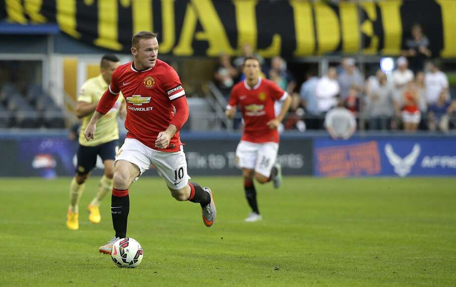 Manchester United's Wayne Rooney looks to pass against Club America in Seattle on Friday night. Photo: Ted S. Warren, Associated Press
