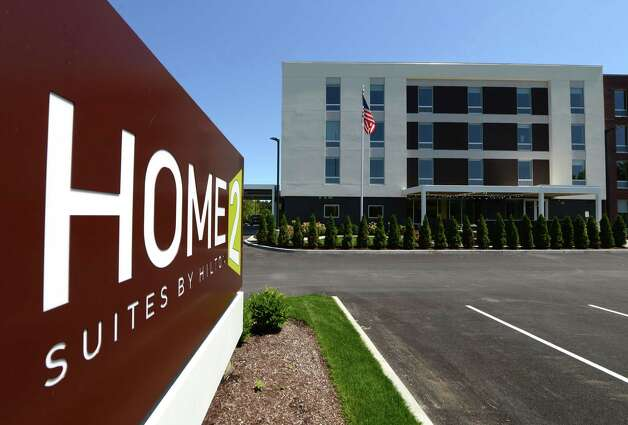 Exterior and sign at the new Home2 Suites by Hilton hotel Monday, July 20, 2015, in Colonie, N.Y. (Will Waldron/Times Union) Photo: WW / 00032675A