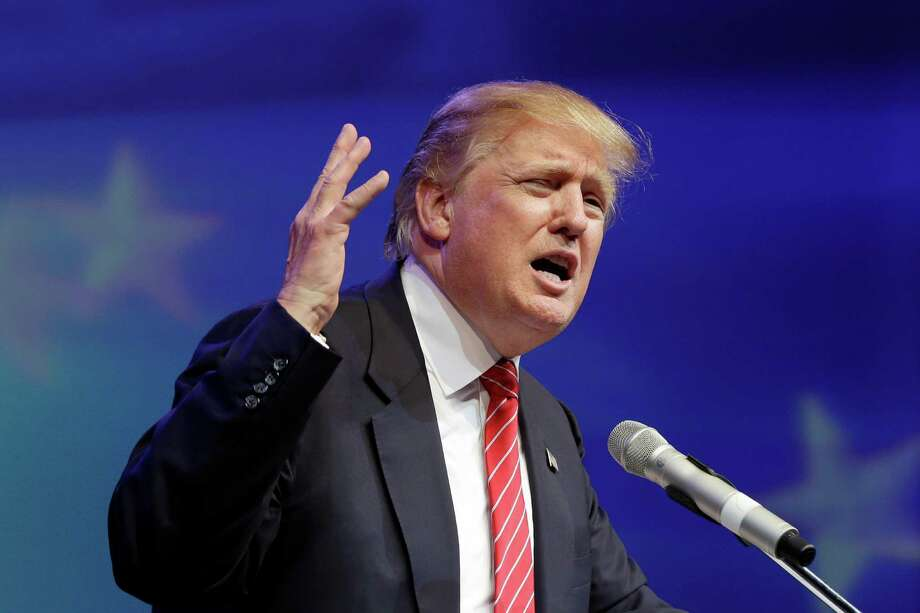 In this July 17, 2015, file photo, Republican presidential hopeful Donald Trump speaks at the Republican Party of Arkansas Reagan Rockefeller dinner in Hot Springs, Ark. Trump faced an avalanche of fresh criticism July 20 for questioning Sen. John McCain's heroism. But he's getting no pressure at all from the one community that could push a candidate out of the 2016 presidential race: political donors. (AP Photo/Danny Johnston) Photo: Danny Johnston, STF / AP