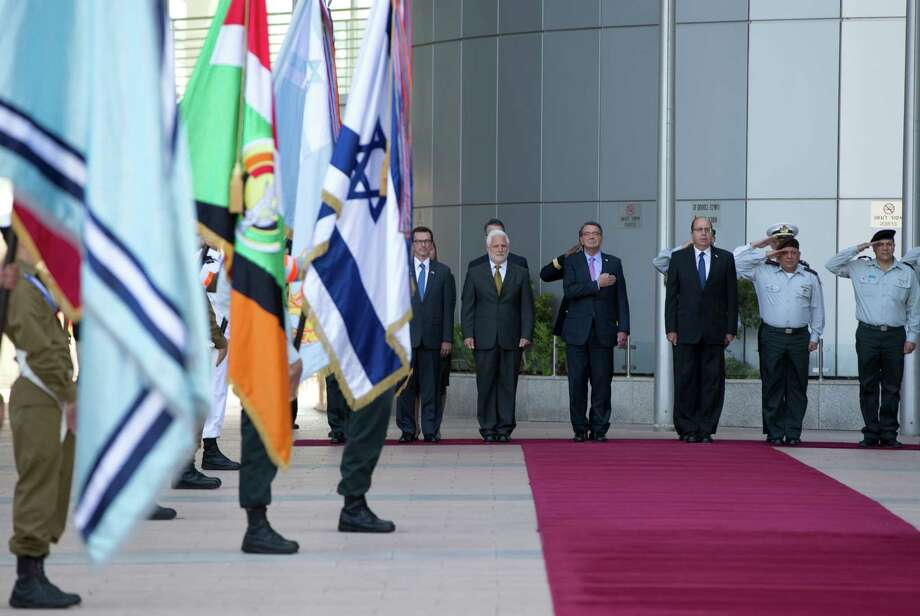 TEL AVIV, ISRAEL - JULY 20:  From left, William Grant, U.S. Embassy Deputy Chief of Mission, Israel Defense Ministry Director General Dan Harel, U.S. Defense Secretary Ash Carter and Israeli Defense Minister Moshe Ya'alon review honor guards at Israel's Defense Force headquarters in Tel Aviv, Israel, Monday, July 20, 2015. Carter said he has no expectation of persuading Israeli leaders to drop their opposition to the Iran nuclear deal, but will instead emphasize that the accord imposes no limits on what Washington can do to ensure the security of Israel and U.S. Arab allies. (AP Photo/Carolyn Kaster, Pool) Photo: Pool, Pool / Getty Images / 2015 Getty Images