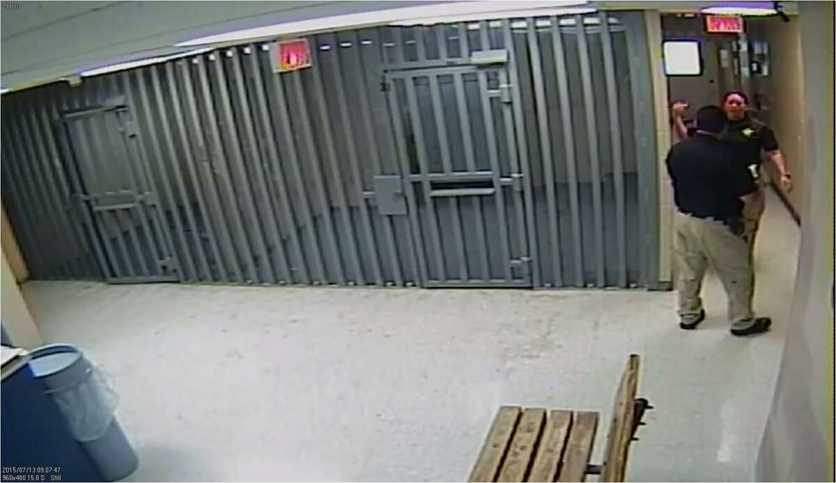 Video still from Waller County Jail, June 13, 2015: Female officer grabs male officer and informs him of what she has seen in Cell 95.