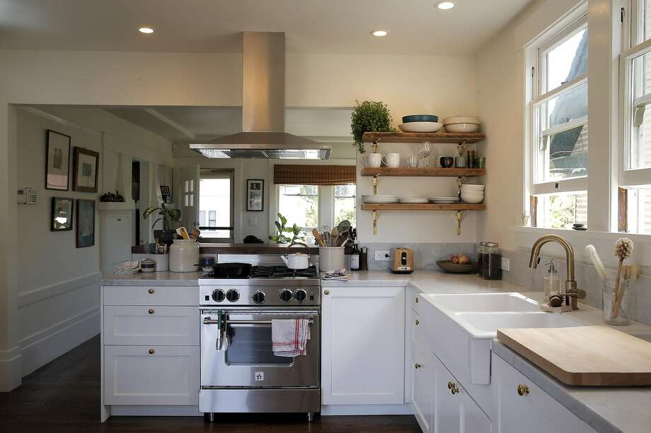 The kitchen in Dona Savitsky's Oakland home was enlarged to let in more light. The remodel improved the flow throughout the home. Photo: Carlos Avila Gonzalez, The Chronicle