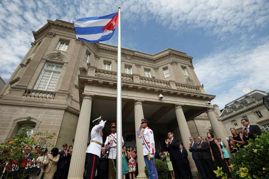 A Cuban military honor guard salutes after the Cuban flag was raised at the nation's embassy in Washington, Monday July, 20,  2015. The opening of the Cuban Embassy was a watershed moment of transition for the two nations as they lean toward closer diplomatic ties. (Doug Mills/The New York Times) Photo: DOUG MILLS, STF / New York Times / NYTNS