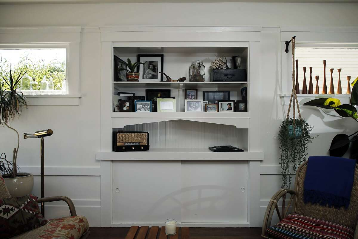 The built-in shelves in the living room in Dona Savitsky's home which she recently remodeled in Oakland , Calif., on Monday, July 20, 2015.