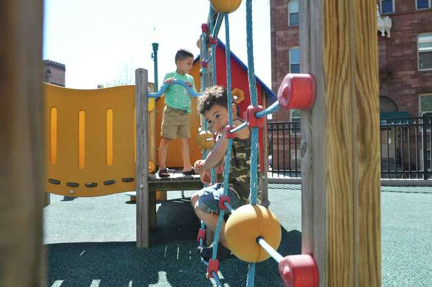 Kyrese, left, 4, and Jayden, 3, play outside at the CEO Head Start program on Monday, July 20, 2015, in Troy, N.Y. Better access to early childhood programs is seen as a way to improve child well-being.  (Paul Buckowski / Times Union) Photo: PAUL BUCKOWSKI / 00032686A