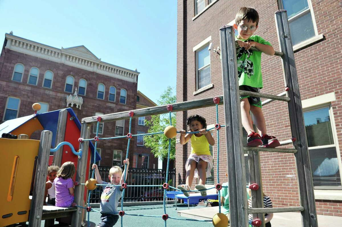 Pre-school children, from left to right, Amari, 3, Lily, 4, Mason, 4, Liberty, 3, and Aiden, 4, play outside at the CEO Head Start program on Monday, July 20, 2015, in Troy, N.Y. Better access to early childhood programs is seen as a way to improve child well-being. (Paul Buckowski / Times Union)