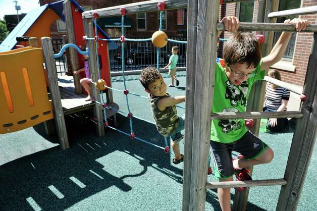 Jayden, left, 3, and Aiden, 4, play outside at the CEO Head Start program on Monday, July 20, 2015, in Troy, N.Y. Better access to early childhood programs is seen as a way to improve child well-being.  (Paul Buckowski / Times Union) Photo: PAUL BUCKOWSKI / 00032686A