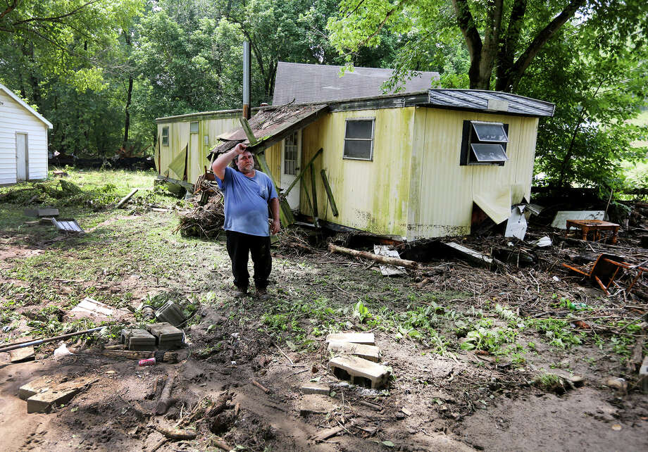 Jeff Downing walks around his property in Ripley, Ohio, where flooding late Saturday swept away the mobile home of relatives. Photo: Liz Dufour /Associated Press / The Enquirer