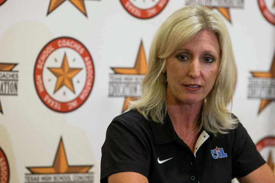 Dr. Susan Elza answers questions as the University Interscholastic League's new athletic director during a news  conference at the Texas High School Coaches Association Coaching School on Monday, July 20, 2015, in Houston. Elza, who was previously Executive Director of Athletics at Northwest Independent School District in Justin, will begin in August and will oversee the UIL athletic department and administer athletic activities for UIL member schools. Elza fills the position recently vacated by Dr. Mark Cousins, who moved into a new role as UIL Director of Compliance, Eligibility and Education on July 1. She will be the UIL's first female athletic director. ( Brett Coomer / Houston Chronicle ) Photo: Brett Coomer, Staff / © 2015 Houston Chronicle