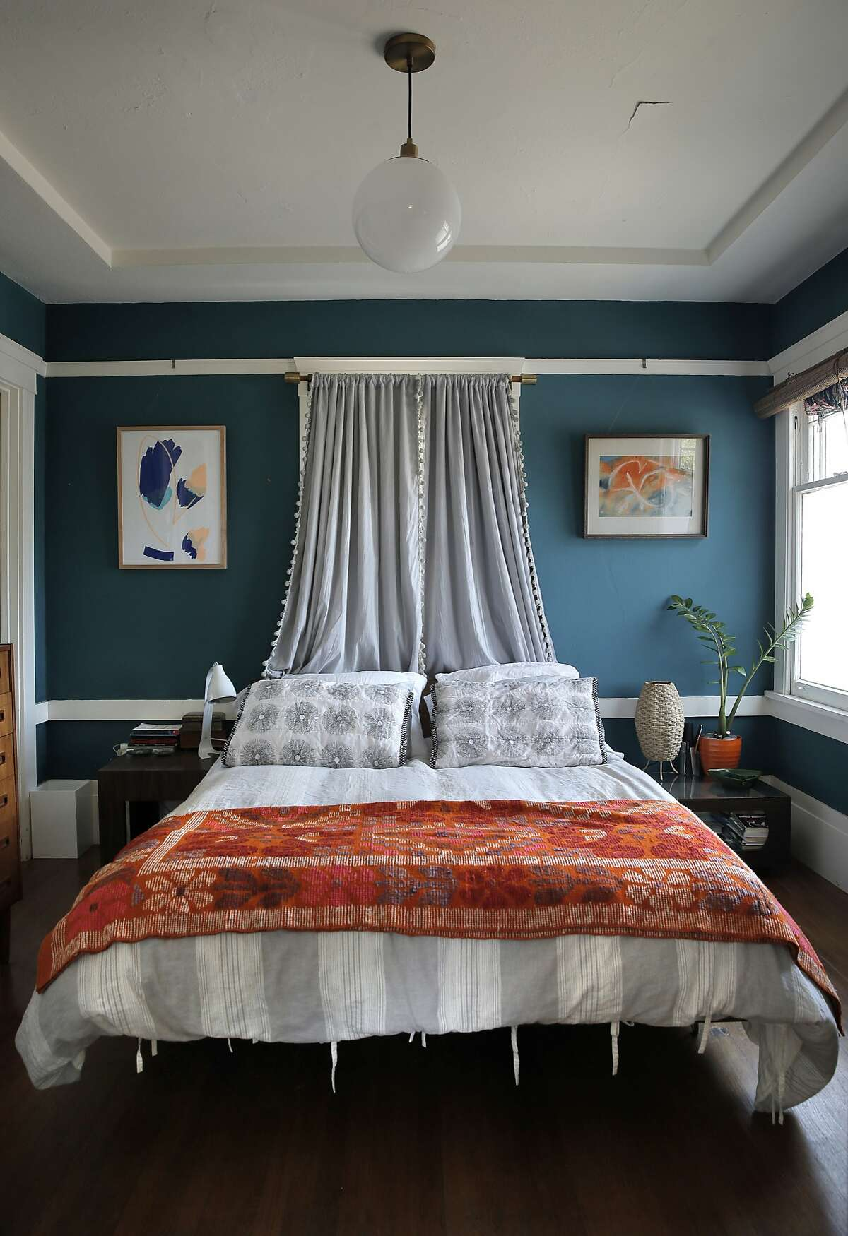 The bed in the master bedroom in Dona Savitsky's home which she recently remodeled in Oakland , Calif., on Monday, July 20, 2015.