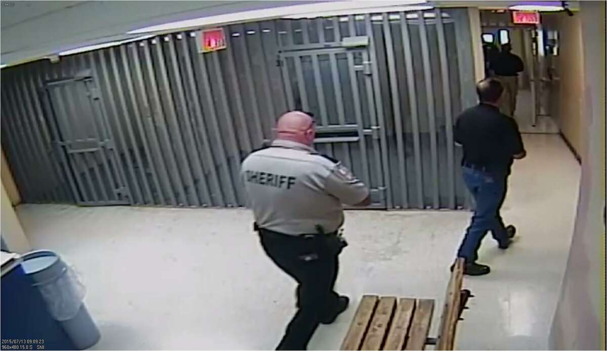 Video still from Waller County Jail, June 13, 2015: More emergency officials respond as CPR is being performed.