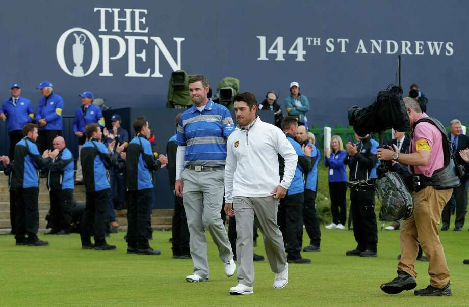 Marc Leishman, left, and Louis Oosthuizen took part in the first British Open playoff since 2009. Photo: David J. Phillip, STF / AP