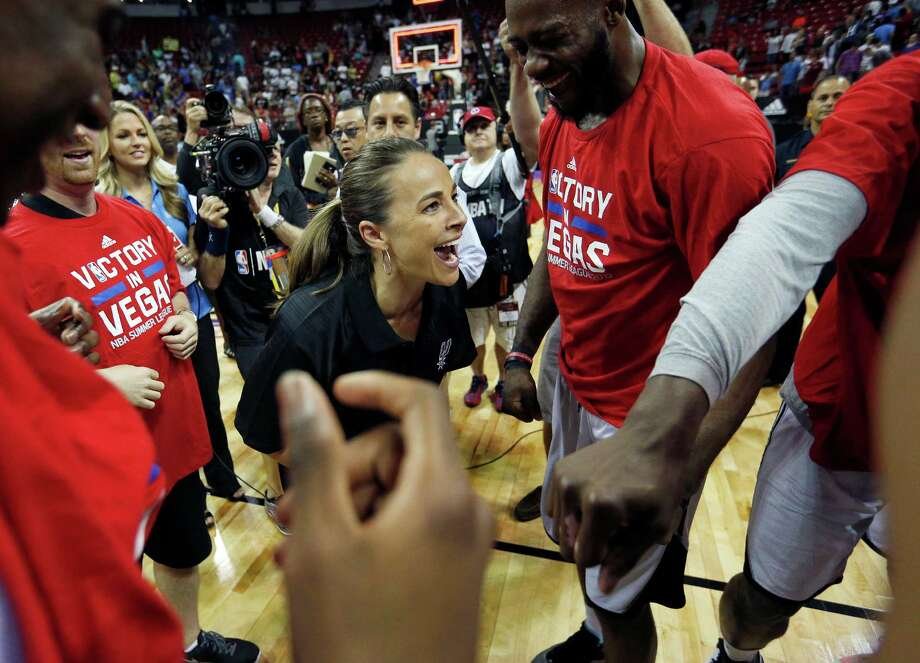 San Antonio Spurs coach Becky Hammon celebrates with her team after they defeated the Phoenix Suns in an NBA summer league championship basketball game, Monday, July 20, 2015, in Las Vegas. (AP Photo/John Locher) Photo: John Locher, STF / Associated Press / AP