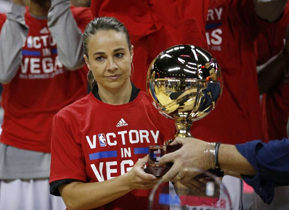 San Antonio Spurs coach Becky Hammon holds up the championship trophy after they defeated the Phoenix Suns in an NBA summer league championship basketball game Monday, July 20, 2015, in Las Vegas. (AP Photo/John Locher) Photo: Associated Press