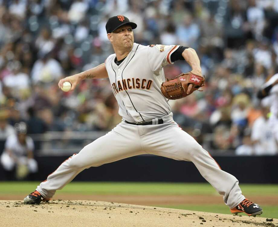 SAN DIEGO, CA - JULY 20:  Tim Hudson #17 of the San Francisco Giants pitches during the first inning of a baseball game against the San Diego Padres at Petco Park July 20, 2015 in San Diego, California.  (Photo by Denis Poroy/Getty Images) Photo: Denis Poroy / Getty Images / 2015 Getty Images