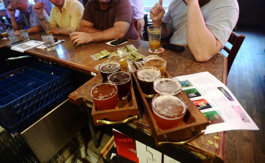 People enjoy the flights of Karbach India Pale Ales during American Craft Beer Week 2014 at Luke's. cat5 file photo Photo: Jake Daniels