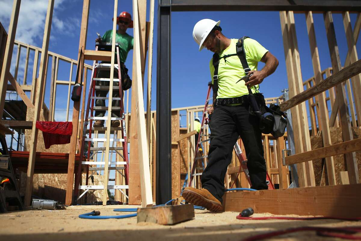 Pete Bazan and Joel Machuca are among several construction workers helping make the second phase of Ron Fernau's