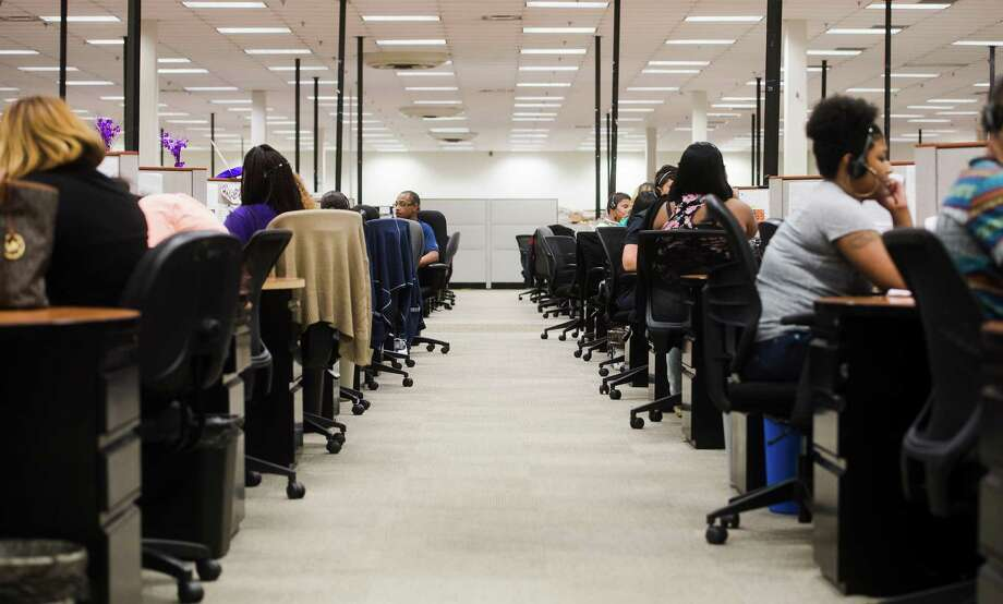 Employees work at the Conn's call center on College Street on Monday. Conn's is planning to hire 240 employees in the Beaumont area, adding to the 800 already employed in the region by the native southeast Texas company.  Photo taken Monday 7/20/15  Jake Daniels/The Enterprise Photo: Jake Daniels / ©2015 The Beaumont Enterprise/Jake Daniels