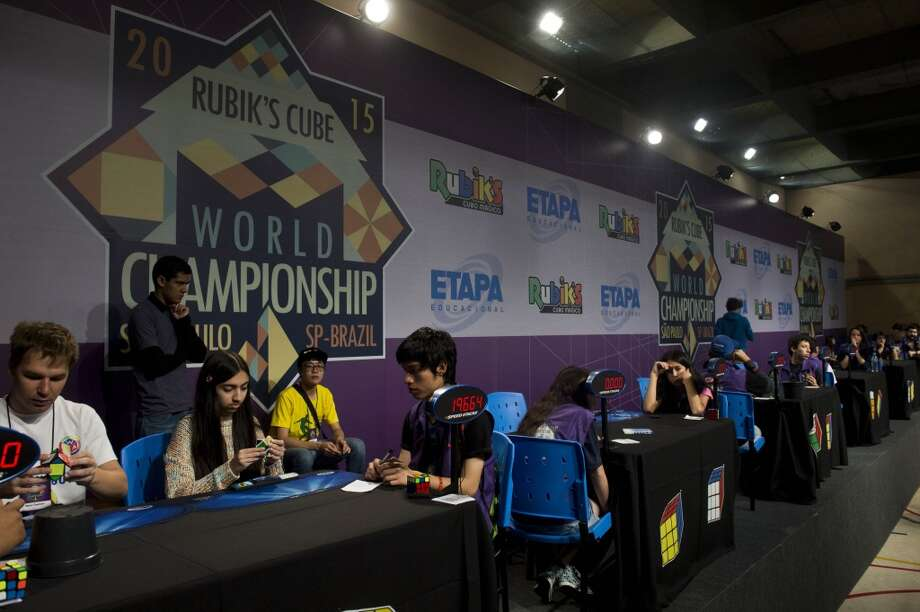 Competitors try to solve Rubik's cubes during the Rubik's Cube World Championship in Sao Paulo, Brazil on July 17, 2015. Four hundred competitors from 40 countries take part in the 2015 event. This six-sided world famous brain teaser was created by Hungarian Erno Rubik in 1974. Photo: NELSON ALMEIDA, AFP/Getty Images