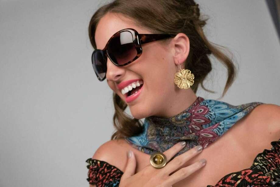 Sundress, $7.49; sunglasses, $9.99, Walgreens. Statement ring, $17.25, earrings, $40, The Wash Tub Boutique. Sheer print wrap, $10, H-E-B. Photo: Billy Calzada /San Antonio Express-News / San Antonio Express-News