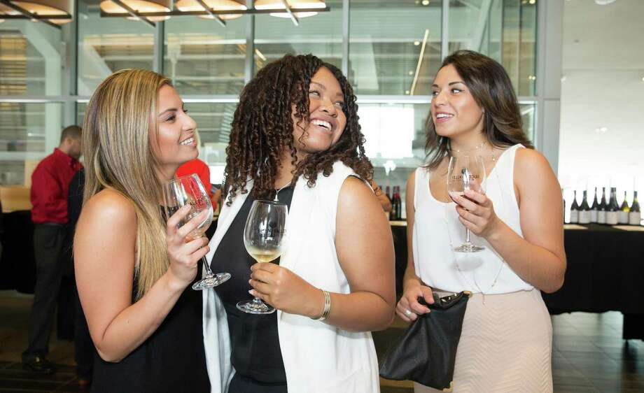 Victoria Astari, Mikaela Martin and Margie Galeano at the inaugural Silicon Valley Wine Auction on June 20, 2015. Photo: Drew Altizer Photography / © 2015 Drew Altizer Photography