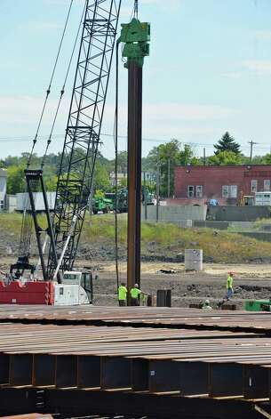 Crews drive 55-foot steel harbor piles to construct Mohawk Harbor at the Rivers Casino site on Erie Blvd. Tuesday July 21, 2015 in Schenectady, NY.  (John Carl D'Annibale / Times Union) Photo: John Carl D'Annibale / 00032694A