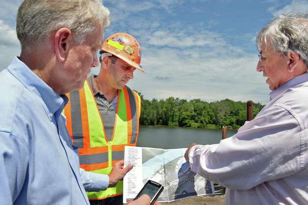 From left, State Canal Corp head Brian Stratton, Rifenburg Contracting's Austin DiSiena and Galesi Group CEO Dave Buicko review plans during a tour of Mohawk Harbor at the Rivers Casino site on Erie Blvd. Tuesday July 21, 2015 in Schenectady, NY.  (John Carl D'Annibale / Times Union) Photo: John Carl D'Annibale / 00032694A