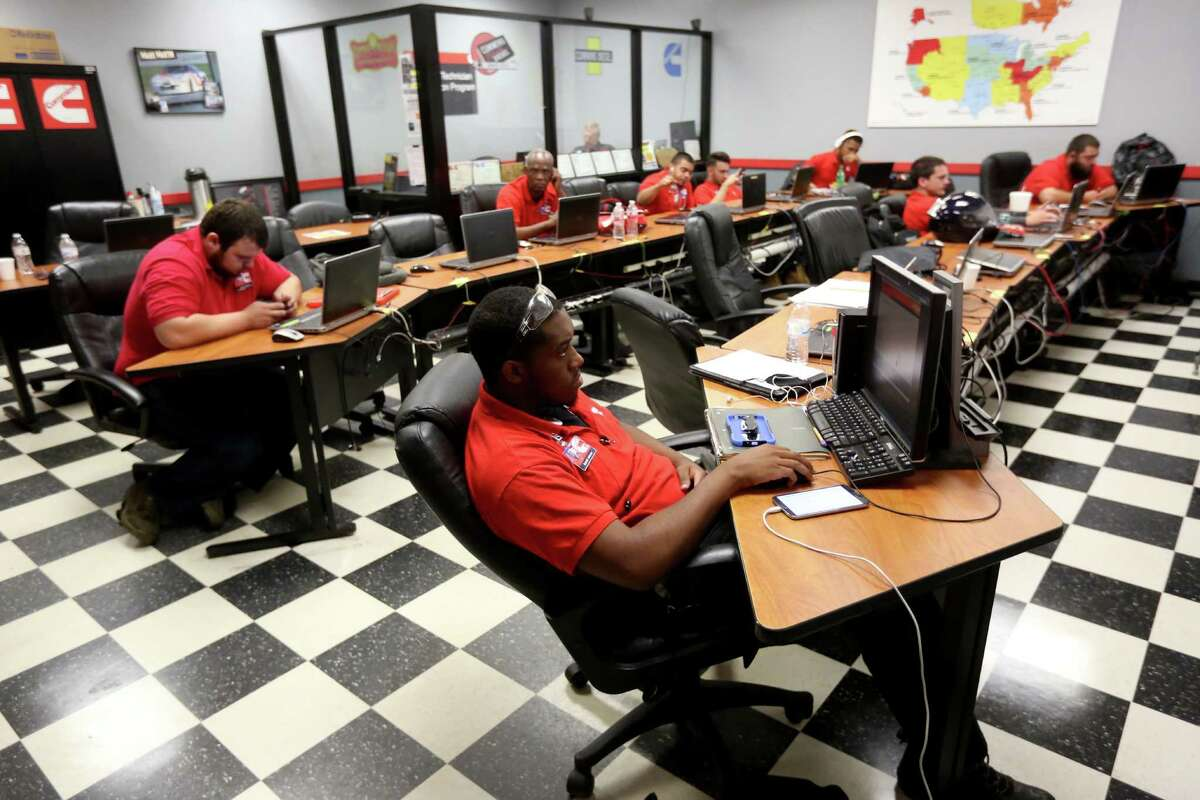 Students take a break during studies in the Cummins Lab at the Universal Technical Institute (UTI), technician training school for the transportation industry, Wednesday, July 15, 2015, in Houston. ( Gary Coronado / Houston Chronicle )