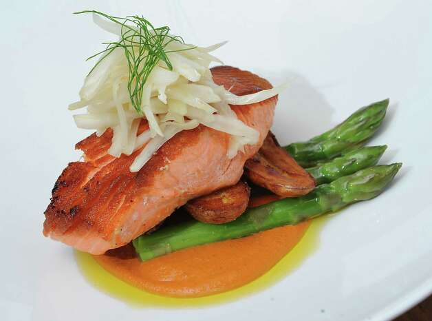Wild king salmon at Mingle on the Avenue on Wednesday, July 30, 2014 in Saratoga Springs, N.Y. Black pepper coriander rub, citrus-fennel slaw, asparagus, roasted fingerling potatoes, romesco sauce.  (Lori Van Buren / Times Union) ORG XMIT: MER2014102317282537 Photo: Lori Van Buren / 0027978A