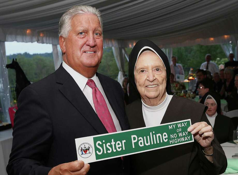 "Saratoga Springs, NY - July 31, 2014 - (Photo by Joe Putrock/Special to the Times Union) - Former Albany Mayor Jerry Jennings(left) presents Sr. Pauline Brecanier, O. Carm.(right), with a ""Sister Pauline, My Way or No Way Highway"" street sign during the Teresian House Foundation's annual gala honoring her.  ORG XMIT: MER2015070711373274 Photo: Joe Putrock / Joe Putrock"