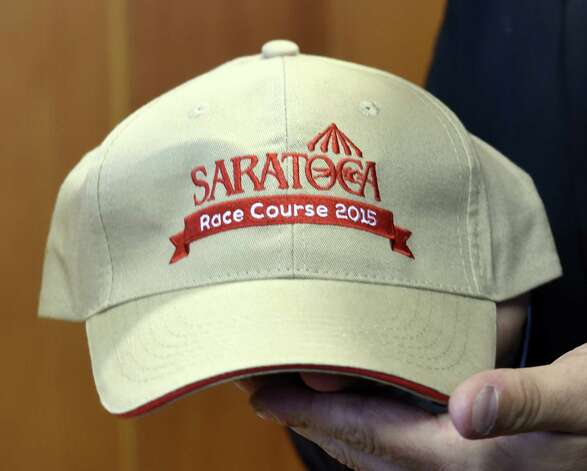 One of the giveaways for the 2015 meeting of the Saratoga Race course is a baseball cap which was previewed during a press briefing Monday June 22, 2015 at the Fasig Tipton pavilion in Saratoga Springs, N.Y.    (Skip Dickstein/Times Union) ORG XMIT: MER2015062216000421 Photo: SKIP DICKSTEIN / 00032328A