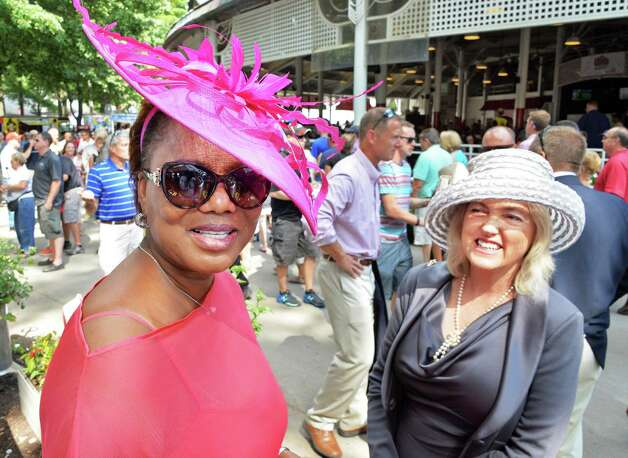 Margot Barnett, left, of Nassau, Bahamas, and Diana Ryan of Saratoga Springs sport perfect examples of a Saratoga hat at Saratoga Race Course Saturday August 9, 2014, in Saratoga Springs, NY.  (John Carl D'Annibale / Times Union) ORG XMIT: MER2014080917152201 Photo: John Carl D'Annibale / 10028088A