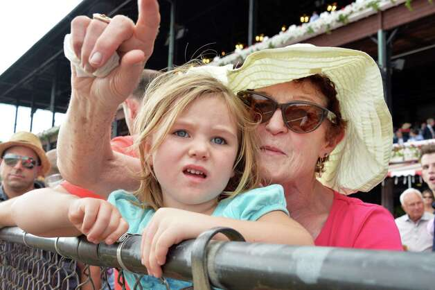 Eileen Coughlan and granddaughter Breen,3, of Westchester County at the rail at Saratoga Race Course Saturday August 9, 2014, in Saratoga Springs, NY.  (John Carl D'Annibale / Times Union) ORG XMIT: MER2014080917195738 Photo: John Carl D'Annibale / 10028088A