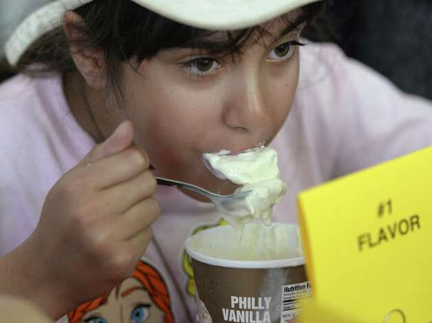 Angelina Angelone 11, of N. Providence R.I. participates in the Stewart's ice cream eating contest Wednesday afternoon Aug. 20, 2014,  at the Saratoga Race Course in Saratoga Springs, N.Y.    (Skip Dickstein/Times Union) ORG XMIT: MER2014082015291496 Photo: SKIP DICKSTEIN