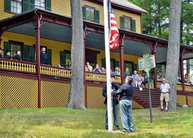 Reenactors raise a flag during the annual Ulysses S. Grant Remembrance Day Wednesday July 23, 2014, at Grant's Cottage in Wilton, NY.  (John Carl D'Annibale / Times Union) ORG XMIT: MER2014072315091709 Photo: John Carl D'Annibale / 00027767A