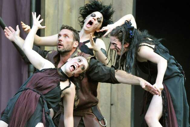 Macbeth, portrayed by Tim Dugan, center, performs with the witches during Saratoga Shakespeare Company's performance of Macbeth on Friday, July 25, 2014, at Congress Park in Saratoga Springs, N.Y. Final show times are Saturday at 6 p.m. and Sunday at 3 p.m. (Cindy Schultz / Times Union) ORG XMIT: MER2015070711511928 Photo: Cindy Schultz / 00027716A