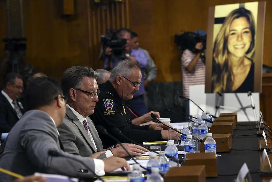 Jim Steinle, second from left, father of Kathryn Steinle, in photograph, testifies next to Montgomery County (Md.) Police Department. Chief J. Thomas Manger, right, before a Senate Judiciary hearing to examine the Administration's immigration enforcement policies, in Washington, Tuesday, July 21, 2015. Kathryn Steinle was killed on a San Francisco pier, allegedly by a man previously deported several times.  Photo: Molly Riley, Associated Press