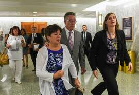 Liz Sullivan and Jim Steinle, parents of Kathryn Steinle, killed on a San Francisco Pier by a man previously deported several times, walk out after a Senate Judiciary hearing in Washington, Tuesday, July 21, 2015. The family told Congress they support changing the laws that allowed her alleged killer to remain in the United States despite being deported several times.  (AP Photo/Molly Riley)