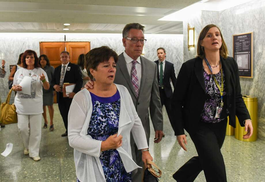 Liz Sullivan and Jim Steinle, parents of Kathryn Steinle, killed on a San Francisco Pier by a man previously deported several times, walk out after a Senate Judiciary hearing in Washington, Tuesday, July 21, 2015. The family told Congress they support changing the laws that allowed her alleged killer to remain in the United States despite being deported several times.  (AP Photo/Molly Riley) Photo: Molly Riley, Associated Press